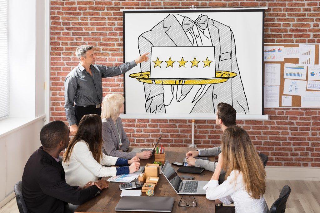 man presenting at a meeting