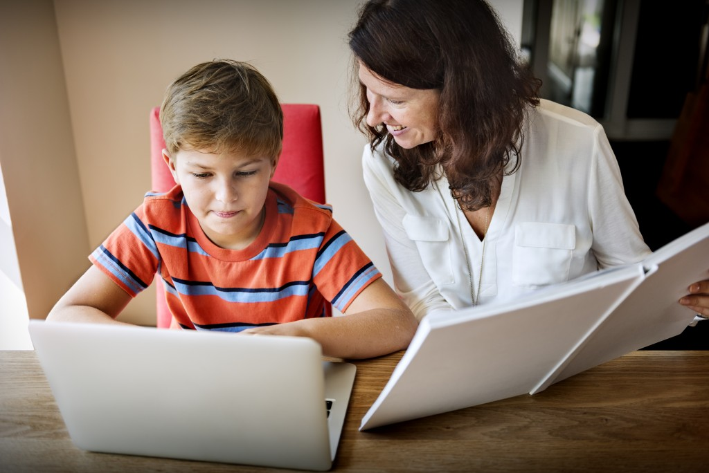 Mom and child using laptop