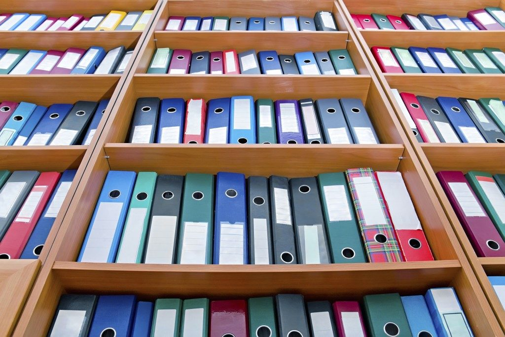 file folders, standing on the shelves in the background