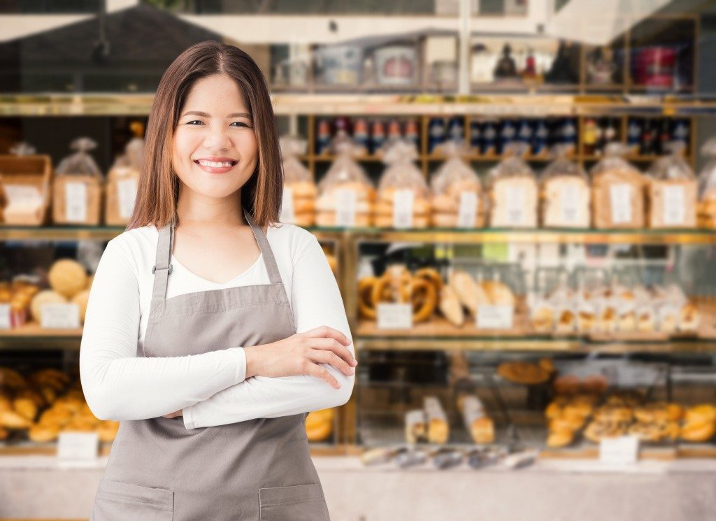 woman smiling at her bakery