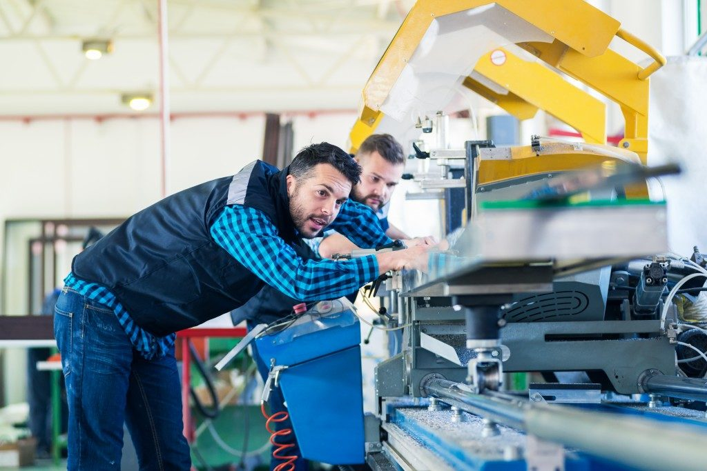 two men inside a manufacturing plant