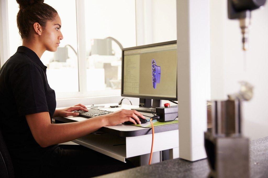 female engineer using computer
