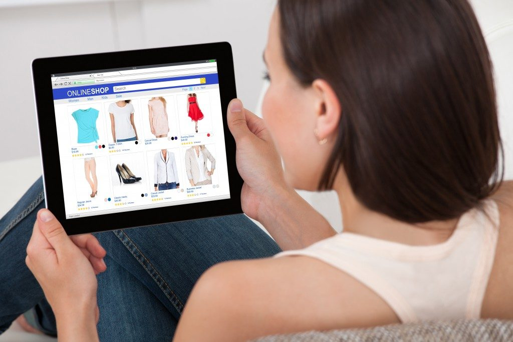 woman shopping clothes online