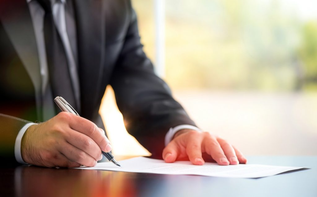 lawyer signing something