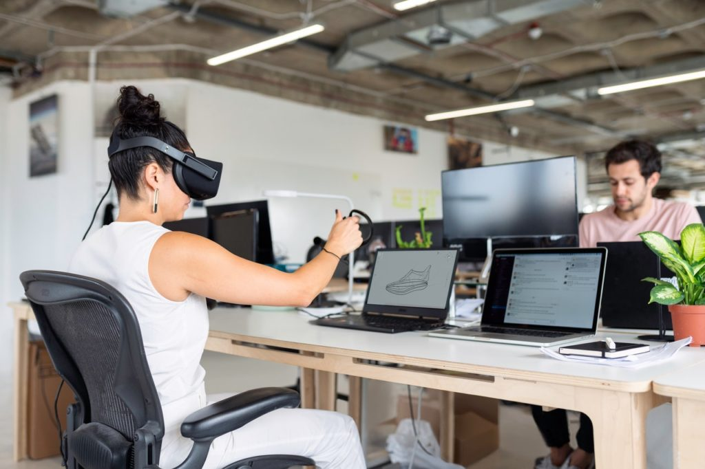 woman using VR to design shoes