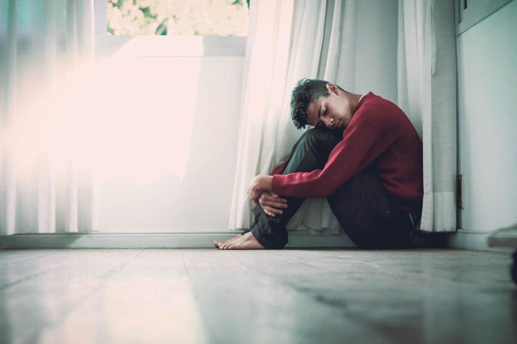 depressed man inside his house